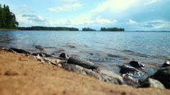 Stony Beach With Calm Water Peaceful Landscape Stock Footage