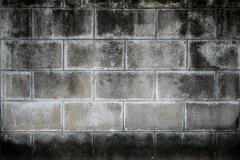 Old dirty concrete block wall Stock Photos