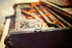 Vintage piano keys with antique pocket watch – time concept, vintage picture Stock Photos