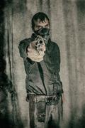 Bandit Gunslinger Pointing Gun Stock Photos