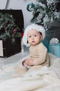 photo of cute baby in Santa hat - stock photo