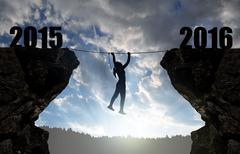 Girl climbs through the abyss into the New Year 2016. - stock photo