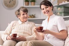Caregiver and senior female - stock photo