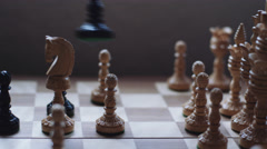 Queen takes a pawn in chess game Stock Footage