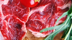 Raw beef medallion on wood Stock Footage