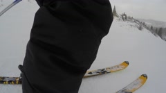 A low gimbal shot of skis going down mountain Stock Footage