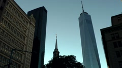 New York City 452 downtown evening; St. Paul's Chapel and One Word Trade Center Stock Footage
