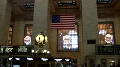 New York City 456 clock and stars and stripes in Grand Central Terminal Stock Footage