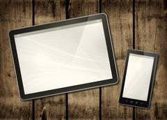 Smartphone and digital tablet PC on a dark wood table - stock illustration