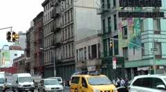 New York City 480 Chinatown district; car traffic and pedestrians in main street Stock Footage