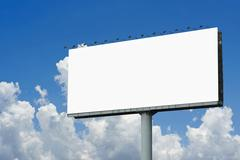 Stock Photo of blank billboard for advertisement on sky background