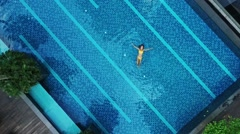Aerial view of big swimming pool in private property Stock Footage