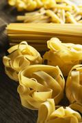 Dry Pasta collection on wooden table. - stock photo