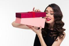 Anticipated attractive curly woman in retro style opening present box - stock photo