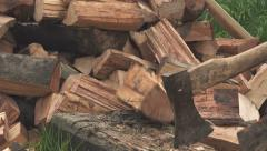 Lumberjack cutting wood logs with axe Stock Footage