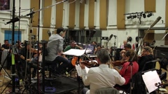 Musicians & Conductor Recording in Music Studio Stock Footage