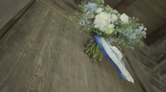 Blue wedding bouquet develops on the background of wooden wall Stock Footage