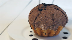 Cake dusted with chocolate sprinkled with chocolate Stock Footage