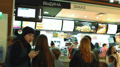 People are waiting an order in Mcdonalds. - stock footage