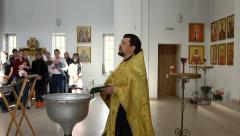 Holy father holds a ceremony of baptism in Church Stock Footage