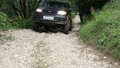 SUV drives into the mountain to impassable mud. Stock Footage