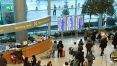 People near information board inside arrival hall Stock Footage