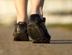 Sports female in black running shoes Stock Photos