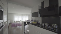 modern kitchen and sitting room - stock footage