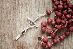 Stock Photo of Silver cross crucifix on wooden background
