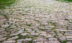 cobblestone pavement in the old town - stock photo