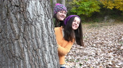 Hide and Seek Girls Playing in Park Hiding by Tree, Stock Footage