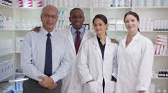 4K Portrait of friendly smiling team of staff in a chemists shop Stock Footage