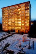 A type of house, block of flats, in beautiful morning light in winter snowy land - stock photo