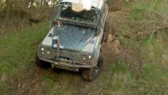 Dirty offroad car slides down the slope Stock Footage