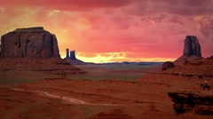 Monument Valley with Background Red Clouds in Timelapse Stock Footage