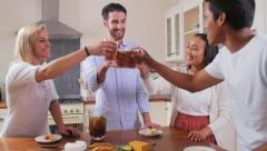 Friends cheers drinks at home - stock footage
