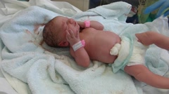 New-born baby and nurse's hands Stock Footage