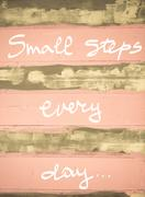 Concept image of Small Steps every day motivational quote hand written on vin Stock Photos