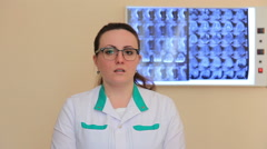 An interviw with young lady doctor (she speaking about medical problems) Stock Footage
