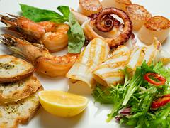 Dish of delicious appetizer with seafood. selective focus Stock Photos