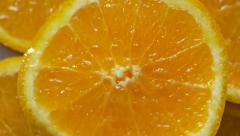 Orange fruit macro twirl - stock footage