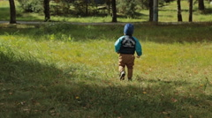 Toddler boy walking in the park, slowmotion - stock footage