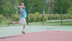 Two-Handed Backhand. Spectacular tennis shot in slow motion. - stock footage