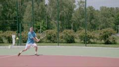 Two-Handed Backhand from the right court's coner. Powerfull tennis shot. SlowMo - stock footage