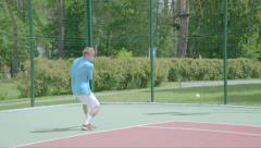 Backhand stroke from the court's coner. Spectacular tennis shot. Slow motion - stock footage