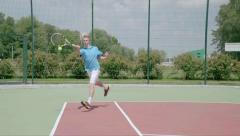 Powerfull forehand. Spectacular shot from professional tennis player. Slow Mo - stock footage