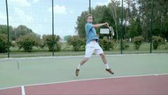Powerful forehand. Spectacular shot with professional tennis player. SlowMo Stock Footage