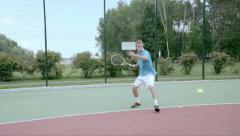 Powerful forehand. Spectacular shot with professional tennis player. Slow motion Stock Footage