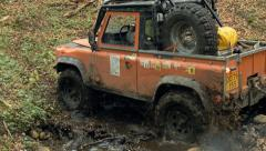 Dirty offroad car crosses the stream Stock Footage
