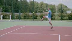 Powerful forehand in jump. Spectacular tennis shot in slow motion. Stock Footage